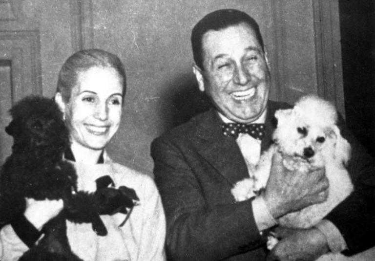 eva-and-juan-peron-with-their-dogs-everett